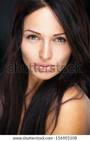 Girl with cute freckles on her beautiful face - stock photo