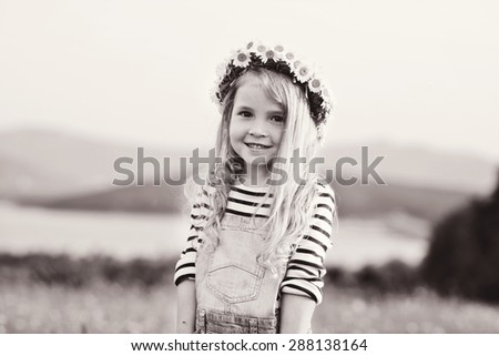 girl with daisy garland on the head - stock photo