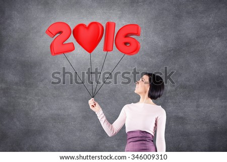 Girl with 2016 date in the form of balloons