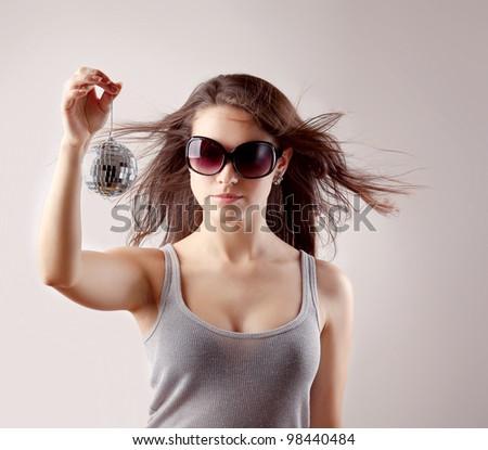Girl with disco ball - stock photo