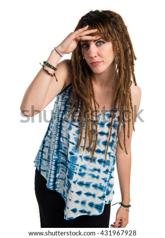 Girl with dreadlocks showing something