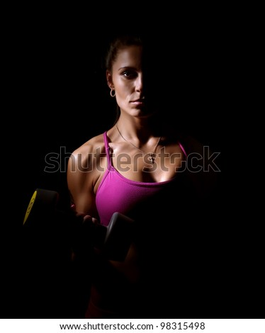 girl with dumbbells - stock photo