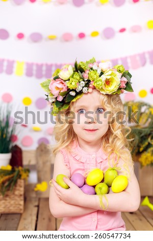 girl with easter eggs, smiling, easter decor