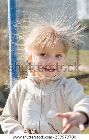 girl with electrified hair - stock photo