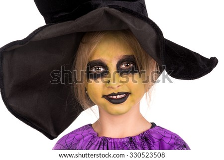 Girl with face-paint and Halloween witch costume isolated in white - stock photo