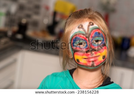 girl with face painting  - stock photo