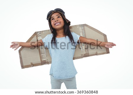 Girl with fake wings pretending to be pilot on white screen - stock photo