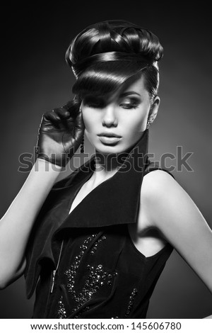 Girl with fantastic hairstyle in black clothes