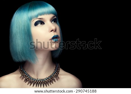 Girl with fashion blue hair over black background. Studio shooting. Art fashion and make up - stock photo