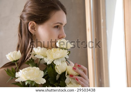 girl with flower looking through the window