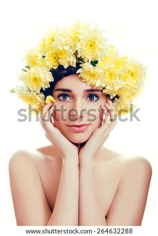 Girl with flower wreath. Caucasian woman with brown eyes and brown hair close up on white background - stock photo