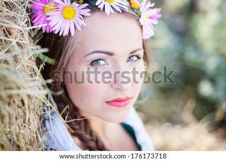 girl with flower wreath outdoors - stock photo
