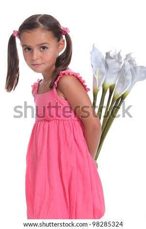 Girl with flowers behind back - stock photo