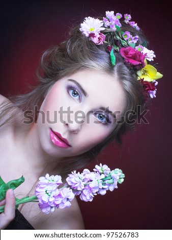 Girl with flowers in her hair and in her hands