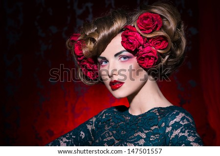 Girl with flowers in her hair  on the red background