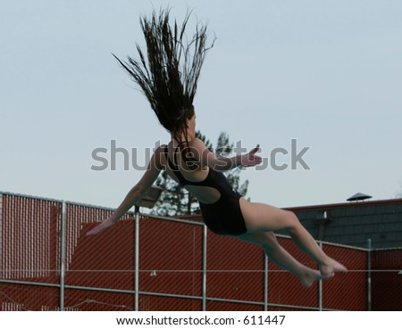 girl with flying hair doing dive