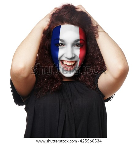 girl with french flag face paint. female soccer fan from france - stock photo