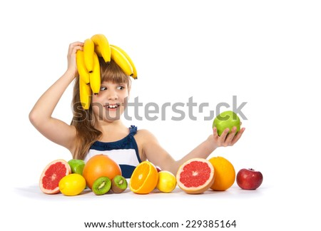 Girl with fruit and bananas on her head - stock photo