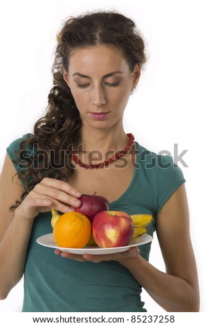 Girl with fruit in your hands on a white background closeup