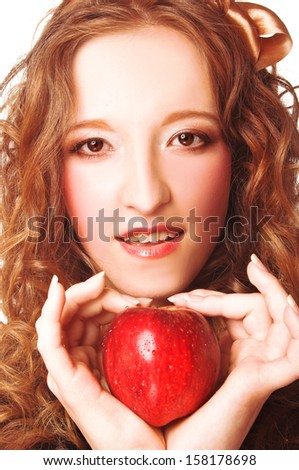 Girl with fruits. Young woman with red apple.