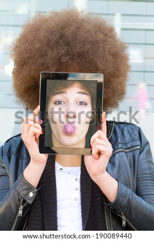 Girl with funny self portrait - stock photo