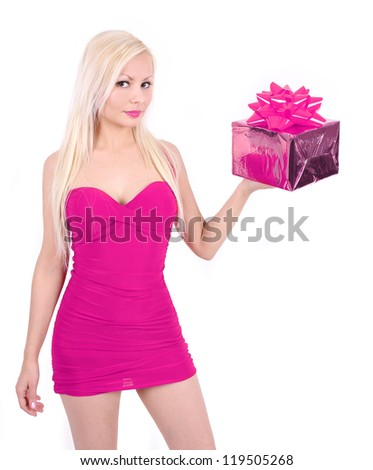 girl with gift box, beautiful blond young woman in sexy hot pink dress holding Christmas present isolated on white