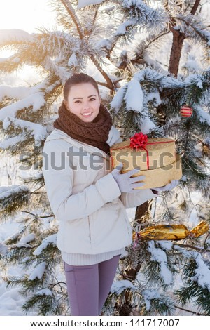 girl with gift in winter park