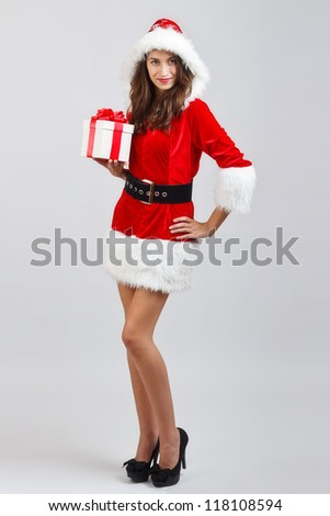 Girl with gift wear santa claus clothes - stock photo