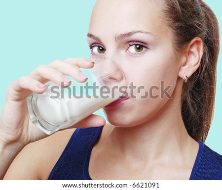 Girl with glass of milk - stock photo