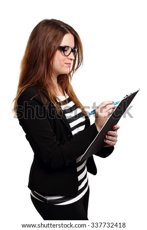 girl with glasses and notes folder writing