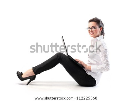 Girl with glasses with a laptop - stock photo