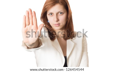 girl with golden hair shows banning hand gesture isolated on white background - stock photo