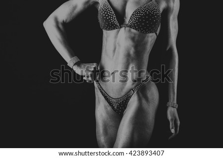 Girl with gorgeous muscular body in a bathing suit
