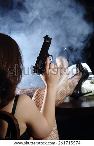 Girl with gun - stock photo