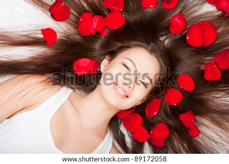 Girl with hair and fluff with rose petals