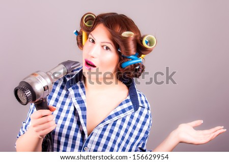 girl with hair dryer - stock photo