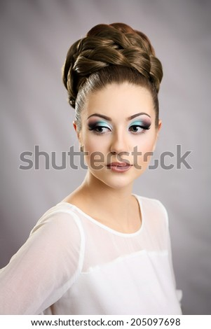 Girl with hairstyle and makeup . Beautiful studio portrait. - stock photo