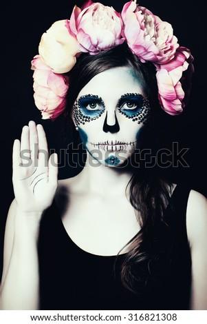 Girl with Halloween Makeup. Sugar Skull Beautiful Woman - stock photo
