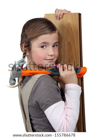 Girl with hammer - stock photo
