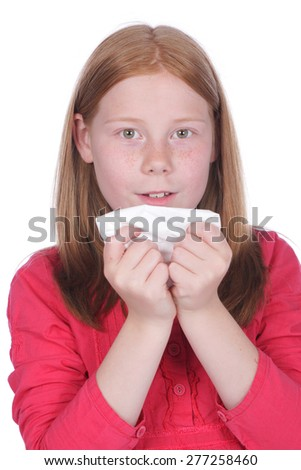 Girl with handkerchief and cold isolated on white - stock photo