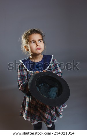 girl with hat in hand asking coins - stock photo