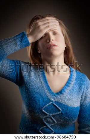 Girl with headache or lot of a trouble - stock photo