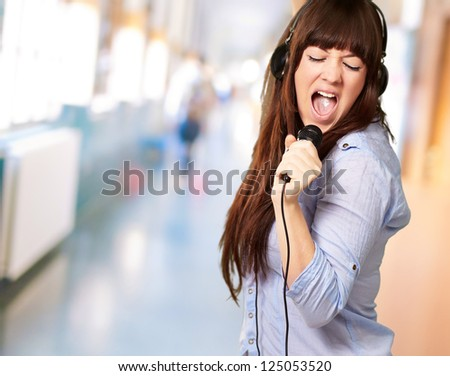 Girl With Headphone Singing On Mike, Indoor - stock photo