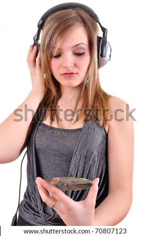 Girl with headphones looking at the cd isolated over white background