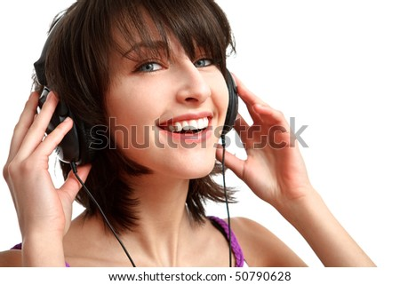 girl with headphones on - listening with smile on her face - stock photo