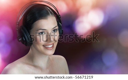 girl with headphones on the blury background