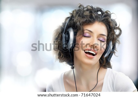 girl with headphones on the window background