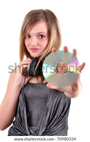 Girl with headphones showing her cd isolated over white background
