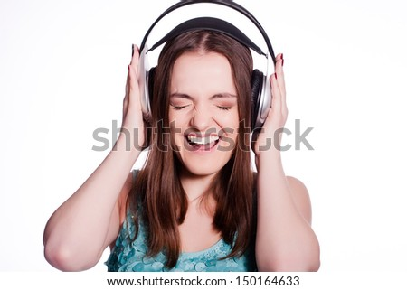 Girl With Headphones Singing and Dancing  On White Background