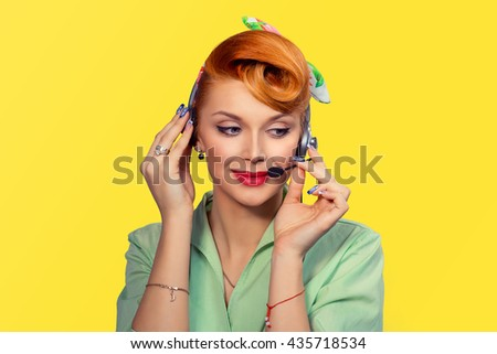 Girl with headset Closeup red head beautiful young woman pretty happy smiling pinup girl green button shirt holding microphone earphone with one hand looking at you camera retro vintage 50's hairstyle - stock photo